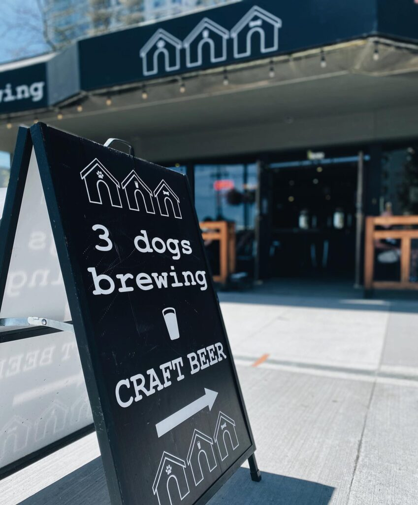 3 Dogs Brewing sign on the street in White Rock